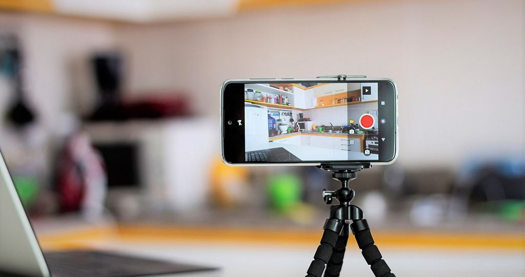 Smartphone ready for vlogging in the kitchen